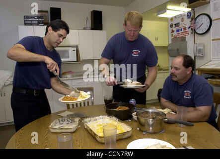 19:38 -- Capt. Eddie Gonzales, 36, left, Firefighter Tim Gleason, 41, middle, and Engineer Gary Hern, 41, right, - Stock Photo