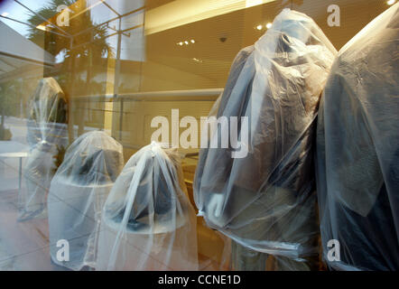 Sep 25, 2004; Palm Beach, Florida, USA; Bags cover display clothing in the Salvatore Ferragamo shop at the corner - Stock Photo