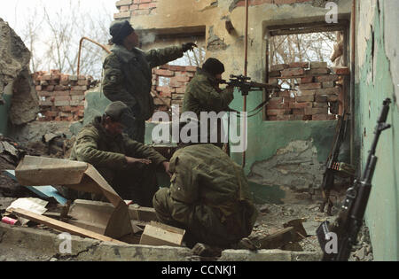 Snipers of russian federal troops at the army operation in Grozny suburbs to destroy chechen rebels. - Stock Photo