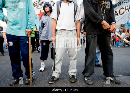 Oct 21, 2010 - Buenos Aires, Argentina - Militant protesters with the Partido Obrero carry pipes and sticks as they - Stock Photo