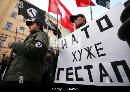 Russian nationalists of the forbidden National Bolshevik party (NBP)with their flags and symbolics at a protest - Stock Photo