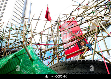 Red Shirts set up barricades with tires and bamboos at Sala Daeng intersection as they face security forces.  Security - Stock Photo