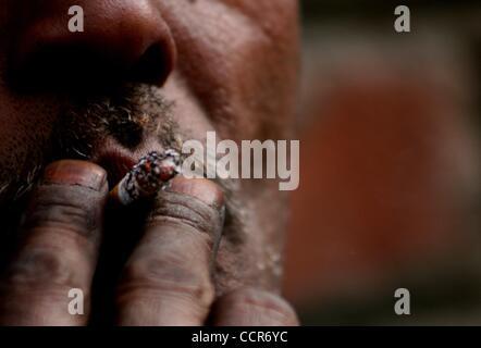 Mar 23, 2010 - Srinagar, Kashmir, India - Kashmiri muslim puffing on a cigarette on World TB Day. The Department - Stock Photo