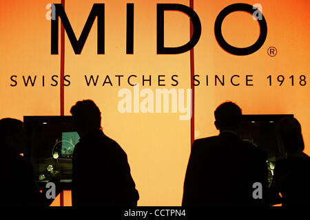 Mar 23, 2010 - Basel, Switzerland - Visitors are seen at the MIDO exhibition stand of the Baselworld 2010 watch - Stock Photo