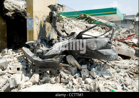 February 24, 2010, Port au Prince, Haiti - A smashed car is a testament to the destructiveness of the January 12 - Stock Photo