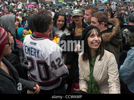 Wearing Canuck's hockey jersey #420, Canada's legalize pot activist Marc Emery known as the 'Prince of Pot' accompanied - Stock Photo