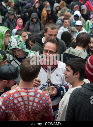 Wearing Canuck's hockey jersey #420, Canada's legalize pot activist Marc Emery known as the 'Prince of Pot' enjoys - Stock Photo