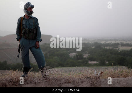 May 25, 2010 - Badghis Province, Afghanistan – An Afghan National Police soldier secures what will become Observation - Stock Photo