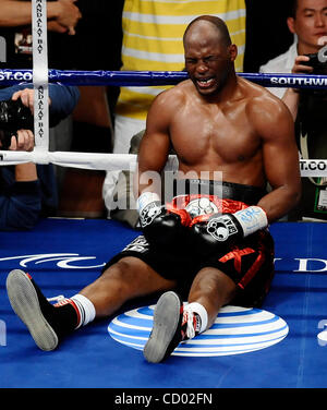 April 3,2010- Las Vegas NV., USA. (in blk/red trunks) Bernard Hopkins goes down after a hit below the belt in the - Stock Photo