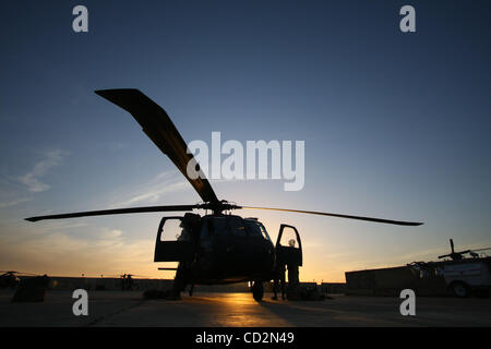Mar 13, 2008 - Baghdad, Iraq - A US Army UH-60 Blackhawk helicopter receives after- flight maintenance on the flightline - Stock Photo