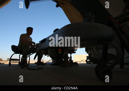 Mar 13, 2008 - Baghdad, Iraq - US soldiers work on an unmanned aerial vehicle inside a maintenance tent next to - Stock Photo