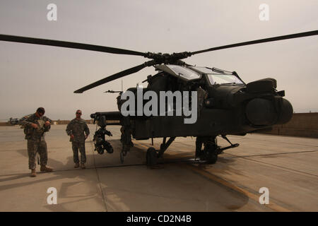 Mar 13, 2008 - Baghdad, Iraq - A US Army pilot and gunner- copilot prepare to board an AH-64 Apache attack helicopter - Stock Photo
