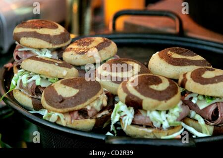Mar 18, 2008 - San Diego, California, USA - Detail view of a Corned Beef Sliders being heated on a grill during - Stock Photo