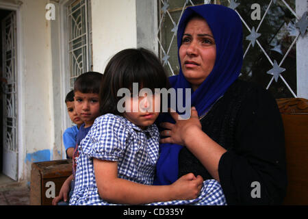 Apr 06, 2008 - Khalis, Diyala Province, Iraq - An Iraqi mother receives instructions to go to hospital with her - Stock Photo