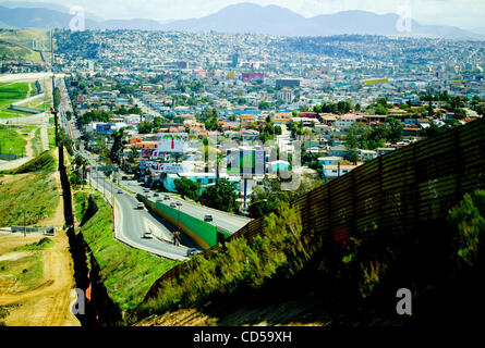 Tijuana viewed from the American side over the border wall - Stock Photo