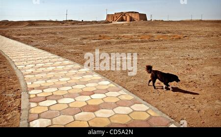 Mar 01, 2008 - Tallil, Iraq - The Ziggurat of Ur looms in the background as a dog walk past a path leading to the - Stock Photo