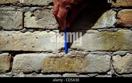 Mar 01, 2008 - Tallil, Iraq - Curator DIEF MOHSSEIN NAIIF AL-GIZZY points to Cuneiform writing on a wall at Sumerian - Stock Photo