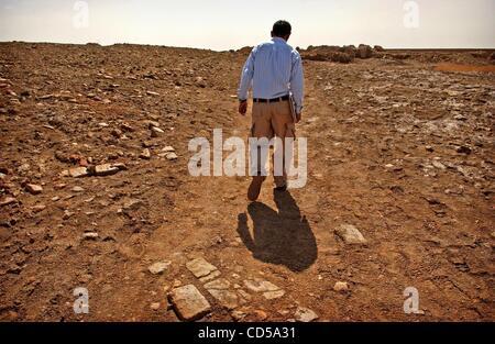 Mar 01, 2008 - Tallil, Iraq - Curator DIEF MOHSSEIN NAIIF AL-GIZZY walks through the Sumerian ruins next to the - Stock Photo