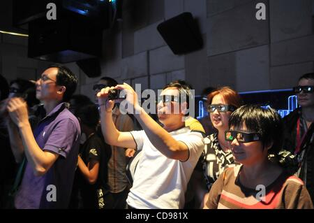 Jun 25, 2010 - Shanghai, China - People watching 3D movie in Chinese pavilion at the World Expo 2010 in Shanghai. - Stock Photo