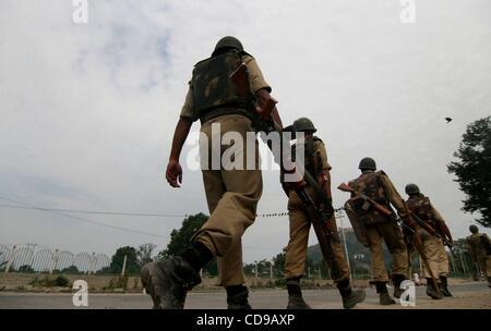 Jun 29, 2010 - Kashmir, Srinagar, India - Indian paramilitary troopers petroling during an undeclared curfew in - Stock Photo