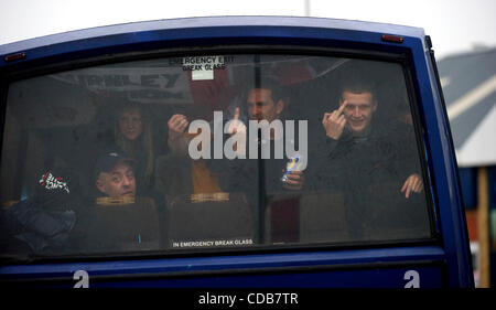 Oct. 9, 2010 - Leicester, England, United Kingdom - Members of the English Defence League (EDL) depart by bus after - Stock Photo