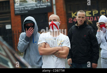 Oct 9, 2010 - Leicester, England, United Kingdom - Wearing face masks, members of the English Defence League (EDL) - Stock Photo