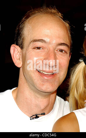 K32368AR.ANNA KOURNIKOVA AND JEFF BEZOS (OF AMAZON.COM) .INTRODUCE ANNA'S NEW SPORTS BRA, .''SHOCK ABSORBER''.AT TENNIS MAGAZINE'S GRAND SLAM; .AN ALL DAY TENNIS FESTIVAL .HELD IN GRAND CENTRAL TERMINAL'S VANDERBILT HALL IN NEW YORK New York. .8/22/2003.     /    2003(Credit Image: © Andrea Renault