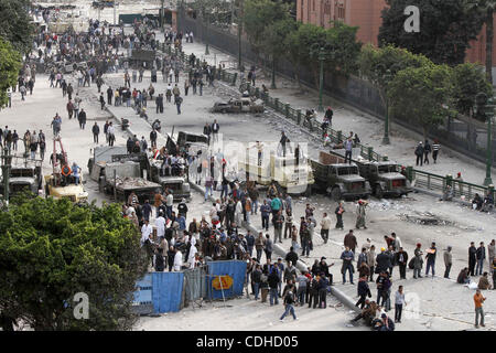 Egyptian protesters are seen in and around Tahrir square, as supporters and opponents of President Hosni Mubarak - Stock Photo