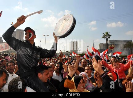 Egyptians celebrate and wave national flags in Tahrir Square in Cairo, Egypt, Saturday, Feb. 12, 2011. Egypt exploded - Stock Photo