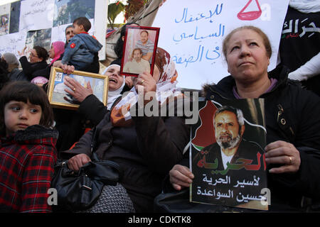 Mar 26, 2011 - Ramallah, West Bank, Palestinian Territory - Palestinians hold pictures of their imprisoned relatives - Stock Photo