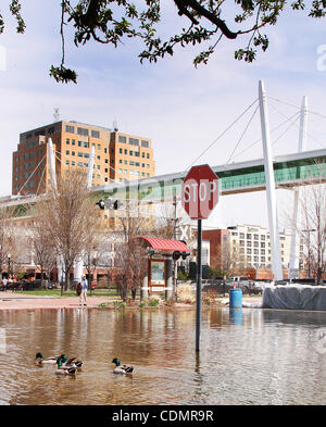Flood waters started spilling into Levee Park in downtown Davenport, Iowa Wednesday April 13, 2011. The Mississippi - Stock Photo