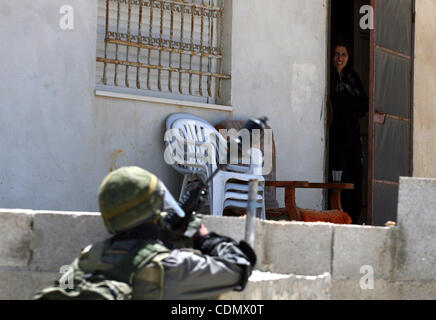Apr 15, 2011 - Ramallah, West Bank, Palestinian Territory - A Palestinian woman stands at her house's door as an - Stock Photo