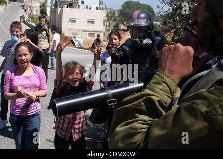 Apr 15, 2011 - Ramallah, West Bank, Palestinian Territory - Palestinian boys take part in a protest against the - Stock Photo