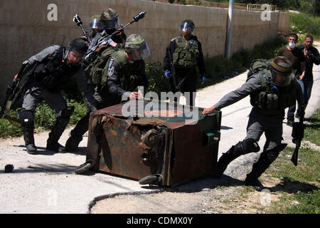 Apr 15, 2011 - Ramallah, West Bank, Palestinian Territory - Israeli soldiers take position during a protest by Palestinian - Stock Photo