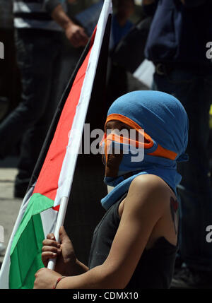 Apr 15, 2011 - Ramallah, West Bank, Palestinian Territory - A Palestinian demonstrator takes part in a protest against - Stock Photo