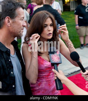 Apr.16, 2011 - Universal City, California, USA -  TERI HATCHER and JAMES DENTON arrive for the 'Block Party on Wisteria - Stock Photo