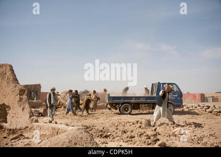 Apr 27, 2011 - Town of Naw Zad, Naw Zad district, Helmand, Afghanistan - Afghan workers collect dirt and dust to - Stock Photo