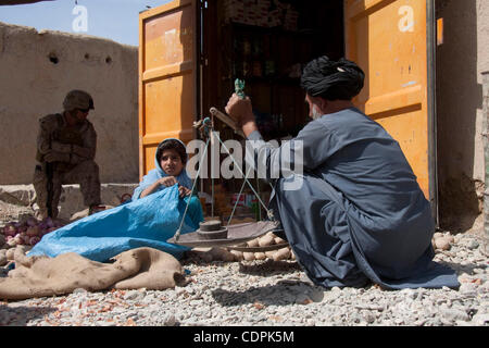 Apr 27, 2011 - Town of Naw Zad, Naw Zad district, Helmand, Afghanistan - A local vendor weighs potatoes on a makeshift - Stock Photo