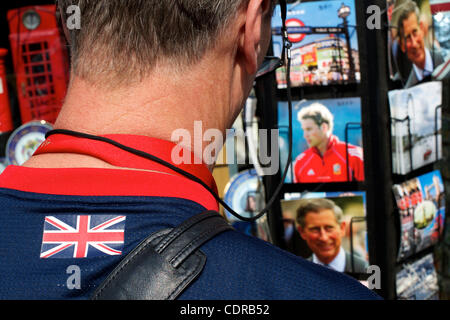 Apr 22, 2011 - London, England, United Kingdom - A tourist surveys the racks of postcards depicting Will and Kate - Stock Photo