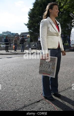 July 10, 2011 - London, England, UK - A television journalist clutches the final edition of the News of the World - Stock Photo