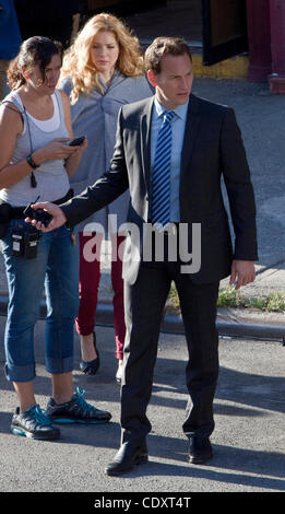 Aug. 23, 2011 - Brooklyn, New York, U.S. - Actors PATRICK WILSON and JULIE BENZ (C-rear) in between takes filming - Stock Photo