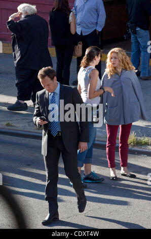Aug. 23, 2011 - Brooklyn, New York, U.S. - Actors PATRICK WILSON and JULIE BENZ (center right ) in between takes - Stock Photo