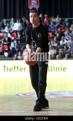 Kai Pflaume throwing a ball during the intermission of a basketball match between FC Bayern and ETB Essen at Olymiahalle - Stock Photo