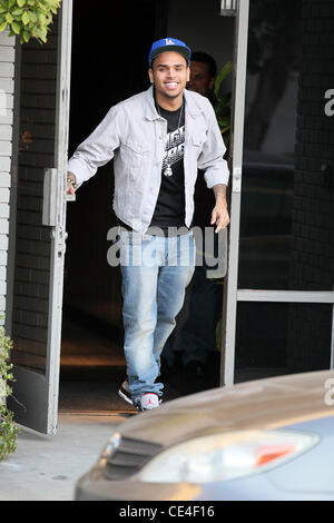 Chris Brown  shows off in front of photographers outside a recording studio in Hollywood. Los Angeles, California - Stock Photo