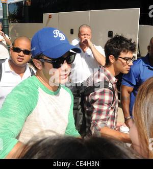 Kevin and Joe Jonas of The Jonas Brothers  leaving the Four Seasons Hotel surrounded by fans. Philadelphia, Pennsylvania - Stock Photo