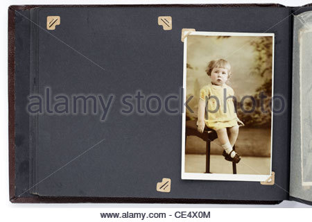 old photo album page with toddler and missing image - Stock Photo