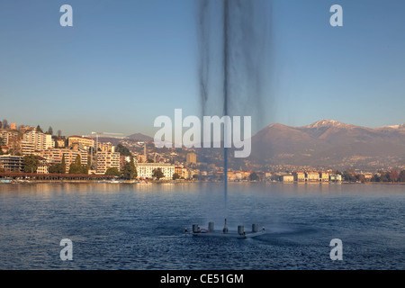 Fountain on the Lago di Lugano in Lugano Paradiso, Ticino, Switzerland - Stock Photo