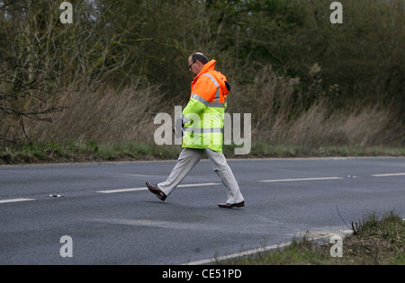 An investigator measures an area of road were a fatal Road Traffic Accident occurred. Picture by James Boardman. - Stock Photo