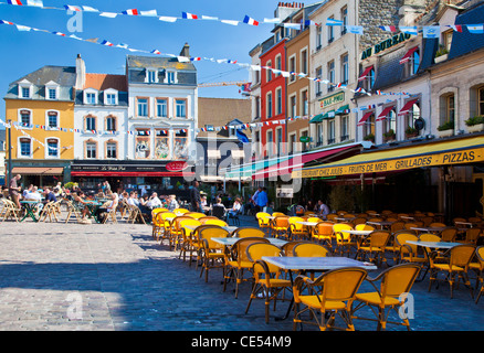 People enjoying the sunshine and chatting at an outdoor cafe in the Place Dalton in Boulogne, France - Stock Photo