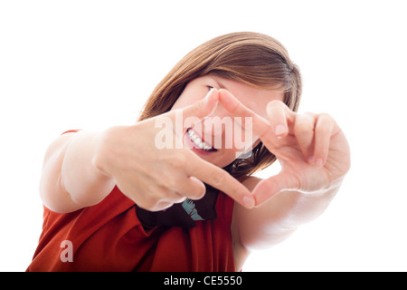 Happy vision concept, young smiling woman framing her face, covering eyes and showing white teeth. Isolated on white - Stock Photo